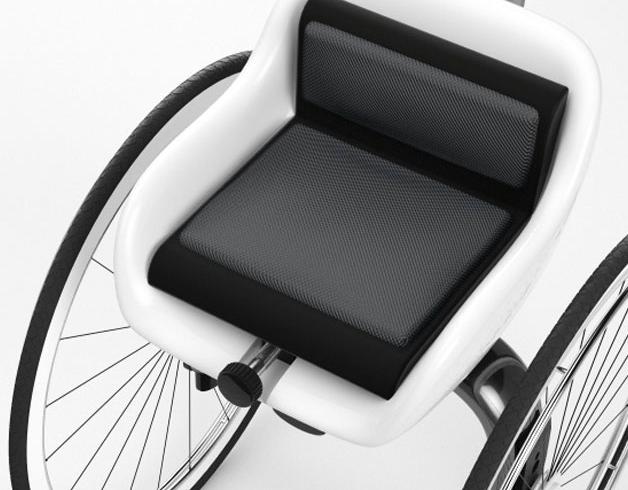 Diapo 2 : Gros plan sur un fauteuil roulant.