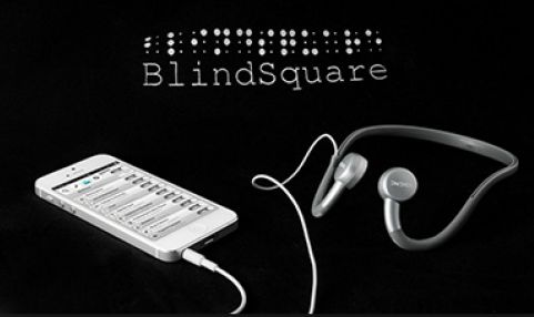 Diapo 4 : Blindsquare sur un téléphone avec un fond noir et des écouteurs à côté