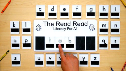 Diapo 5 : Photo de l'innovation The Read Read, avec des lettres traduites en braille