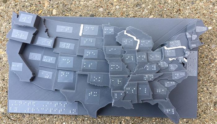 Diapo 2 : La carte des états unis en relief avec du braille pour faciliter la compréhension