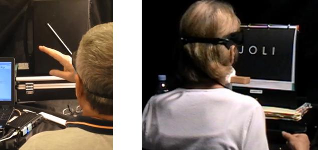Diapo 2 : Deux personnes de dos qui testent Prima avec des exercices sur un écran d'ordinateur, on voit qu'ils ont les lunettes qui accompagne le dispositif