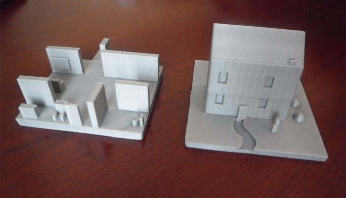 Diapo 3 : deux modèles de maisons imprimés en 3D