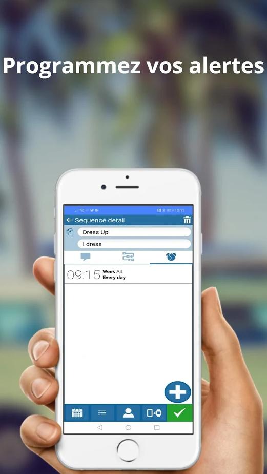 Diapo 3 : un smartphone tenu dans une main avec un exemple d'alerte à programmer